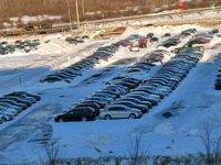 Cars in snowy parking lot by hotel wide Mar 11 19.jpg